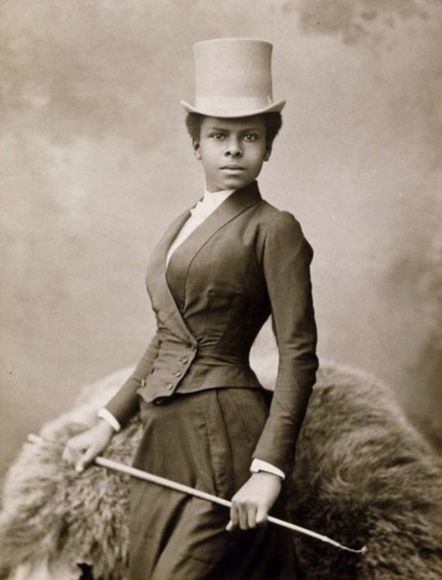 Stylish African American woman with riding crop