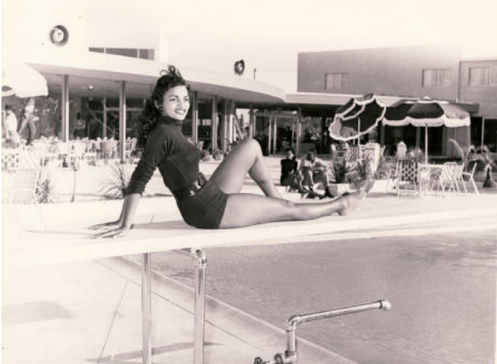 Showgirl by pool at the Moulin Rouge hotel and casino in Las Vegas, 1955